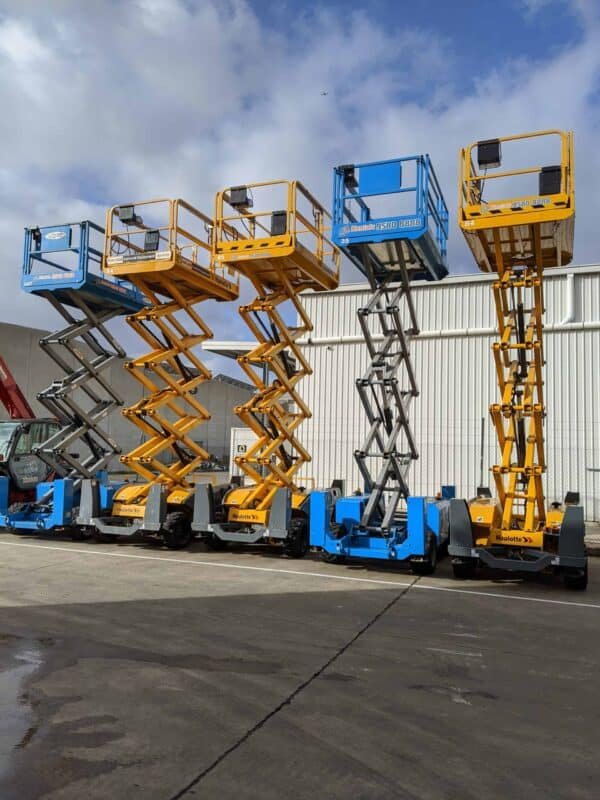 rough terrain scissor lifts lined up pic 1